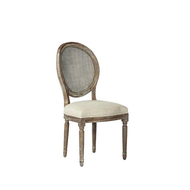 Elegant French Louis XVI style round back dining chair. Consists of a solid oak frame featuring rattan backs and neutral...