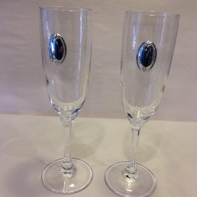 Still in the original Valenti and Co. box, 2 classy champagne flutes. Classic style with silver medallion.