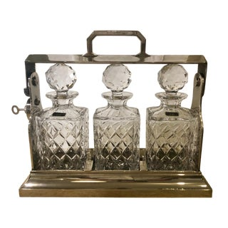 Antique English Silver Plate Tantalus with Cut Crystal Decanters - Set of Three For Sale
