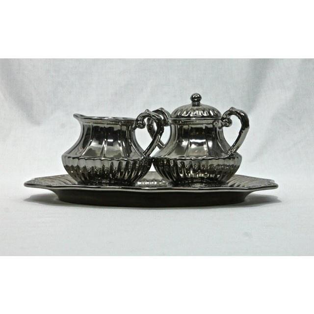 Vintage Godinger creamer, sugar & tray in a beautiful silver lusterware finish. Excellent condition with no chips, cracks,...