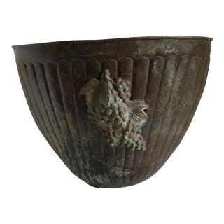 Rustic Metal Vessel With Grape Design For Sale