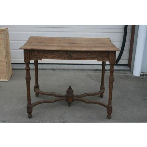 Incredible 18th century French oak table with exquisite carvings and single drawer. A very unique piece of incredible...
