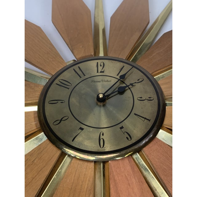 Very nice walnut and brass starburst clock made in the 60s.