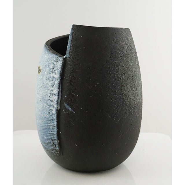 Beautiful Japanese folded design vessel with black to white glaze and textured areas.