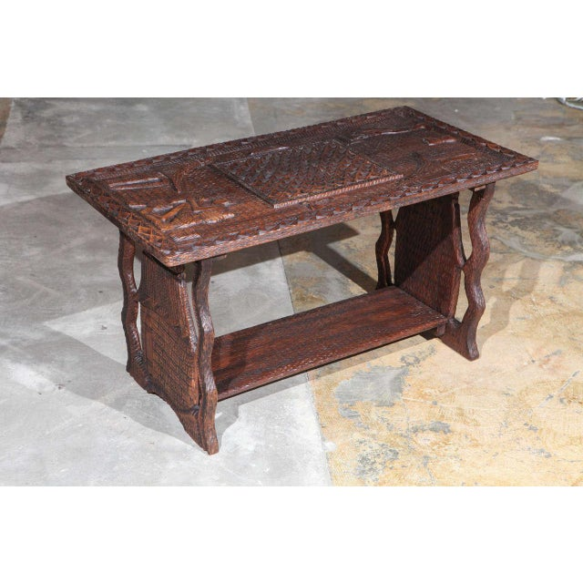 African coffee table from Kandondo of DR Congo with highly detailed carvings.