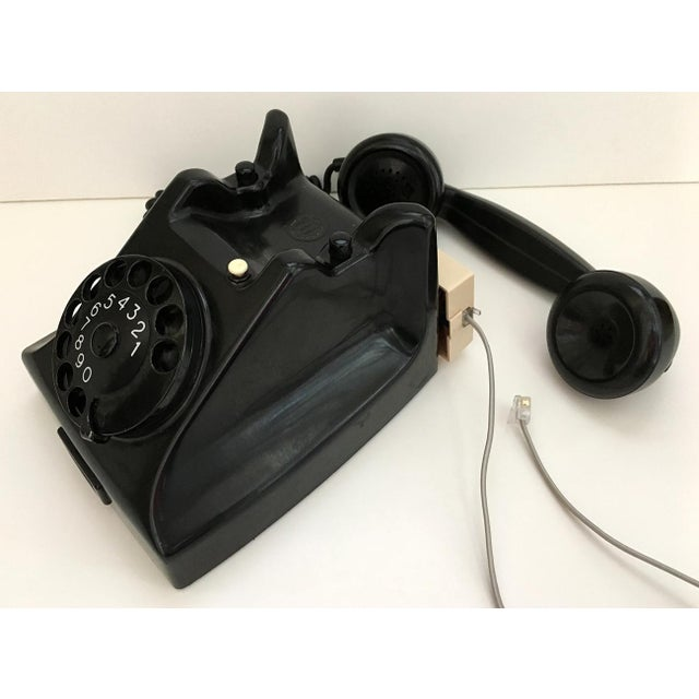 Vintage telephone with modular plug adapter, converted in 1979. Heavyweight PIT brand bakelite phone with metal rotary...