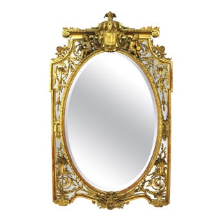 French Louis XVI Style Giltwood Mirror with Putti and Oval Center, 19th Century For Sale