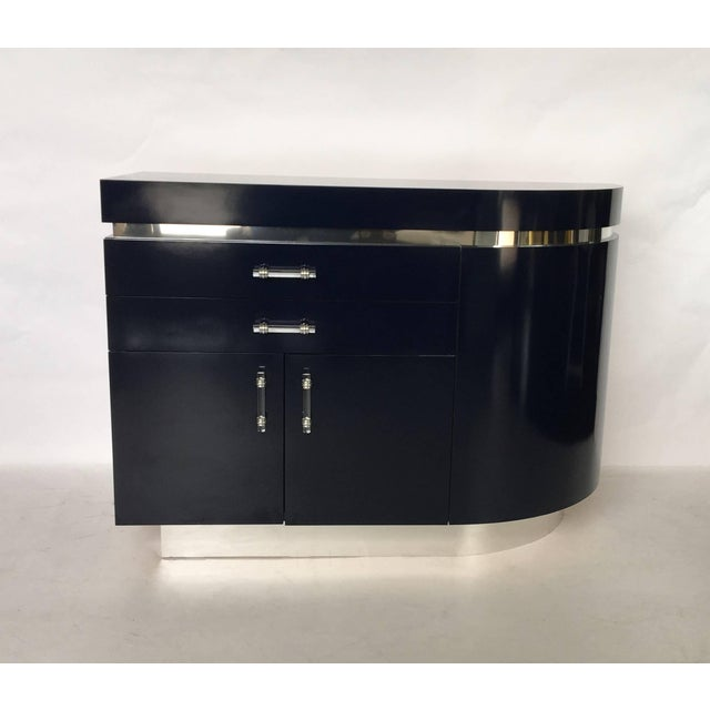 "Pair of large navy blue Wade Beam for Brueton ""Ponte"" nightstands, with radiused ends. Featuring two-drawers, two doors on..."