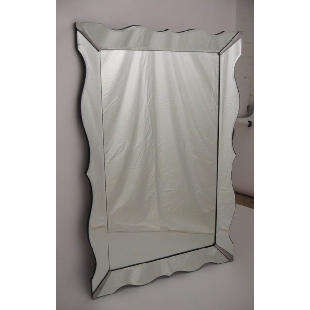 Massive Hollywood Regency Moderne scalloped bevelled mirror. The canted scalloped edge panels are decorated with an etched...