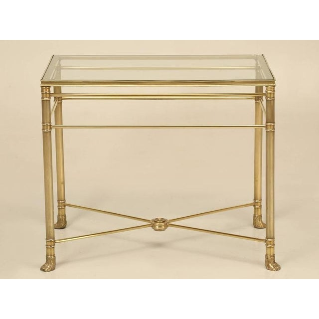 Elegant vintage French solid brass Mid-Century Modern end table with a glass top. Polished un-lacquered brass that will...