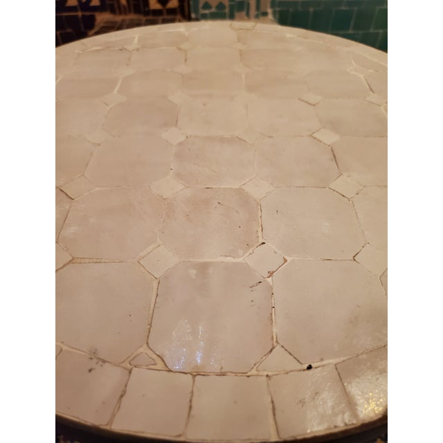 """All White Mini Moroccan Mosaic table, measuring 16"""" in diameter, and 18"""" in height. Comes with a wrought iron folding..."""