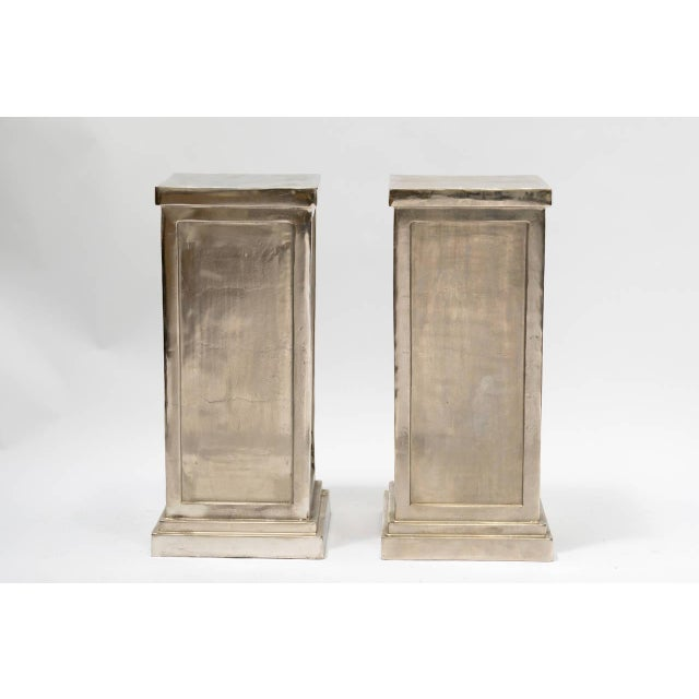 Pair of classical style metal alloy pedestals - fun twist on a Classic piece of architecture.