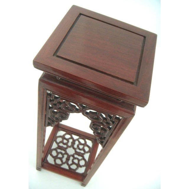 A beautifully made tall form pedestal. An intricately hand crafted, classic yet traditional Ming style rosewood curio...