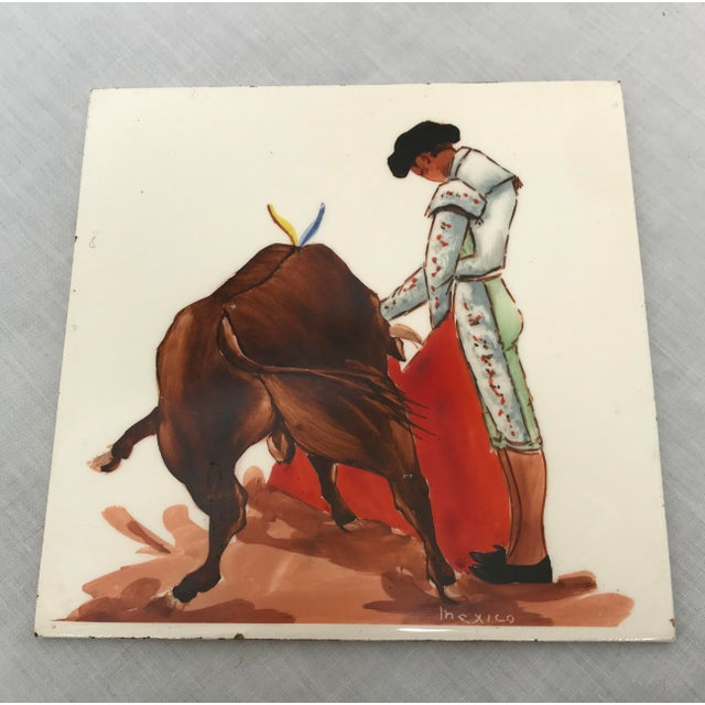 Here are six vintage hand-painted Mexican ceramic tiles depicting toreros fighting bulls. Colors are vivid and design is...
