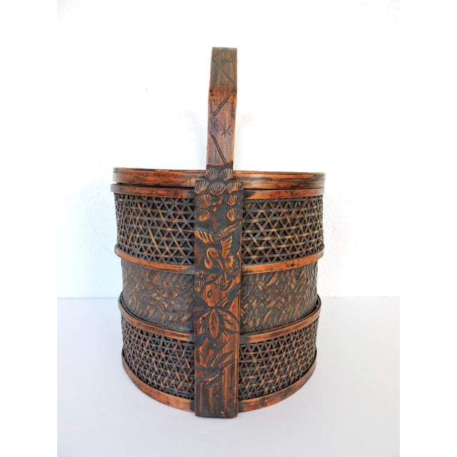 Intricately woven Chinese basket with a hand carved decorated handle - similar to a Chinese Wedding Basket or Chest. This...