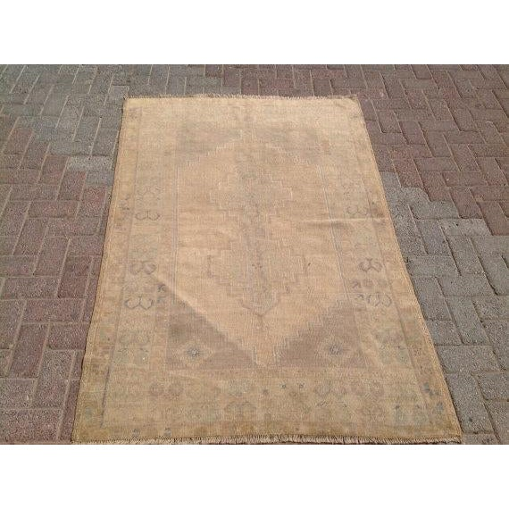 This gorgeous han- knotted vintage Anatolian area rug is approximately 70 years old. In excellent vintage condition. The...