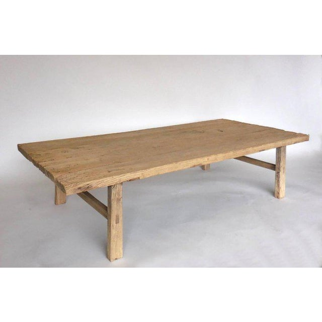 Very old weathered, smooth elm from Northern Japan atop straight legs and stretchers. Some age appropriate wear, sturdy...