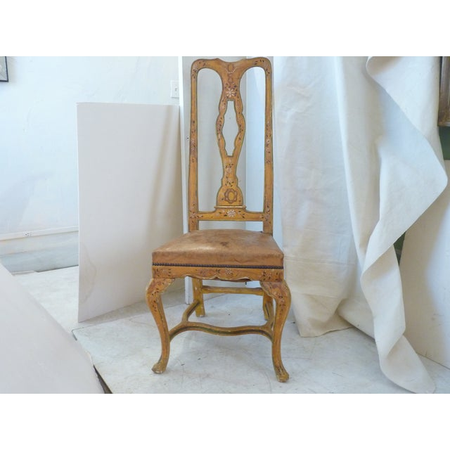 """French hand--painted side chair with leather seat cabriole legs, cross-bar, and 19"""" height seat. The piece dates back to..."""