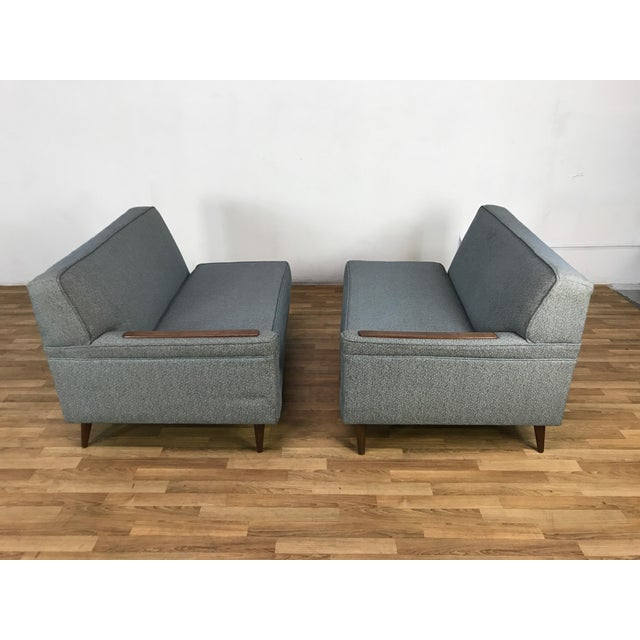 This is a two pieces sofa,totally Mid Century style,,upholstered in fabric,, in a retro blue color. Comes with a classic...