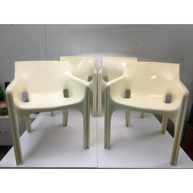 Set of 4 iconic modern molded fiberglass Gaudi armchairs by Vico Magistretti for Artemide, Italy. Each chair is signed on...
