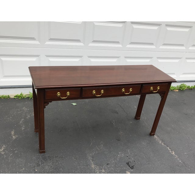 Chippendale sofa table with two benches by Harden. Three drawers with beautiful brass hardware. Carved details under...