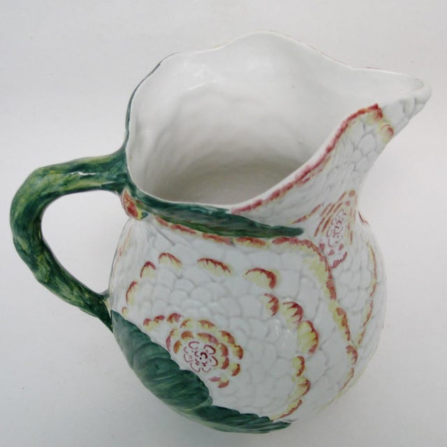 Vintage majolica Italian pitcher with oversized embossed white flowers with hand-painted soft red and pale yellow petals....