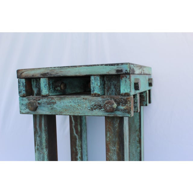 A great looking tall Metal pedestal made of metal with an acid green patina . Designed by an interior designer in LA . All...