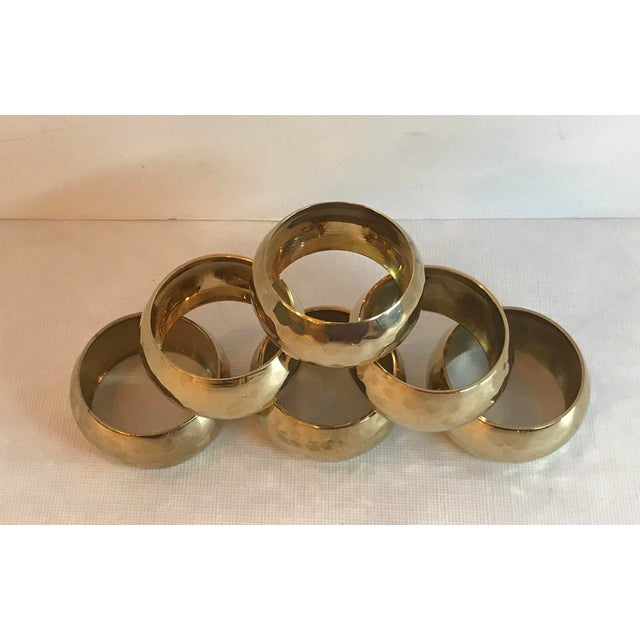 Nice set of six solid brass napkin rings with a hammered design.