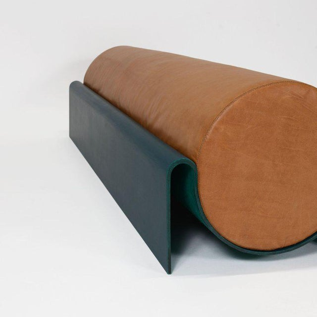 The sculptural monitor bench is a strong center piece for a lobby, a graphic ending to a master bed, or a statement...