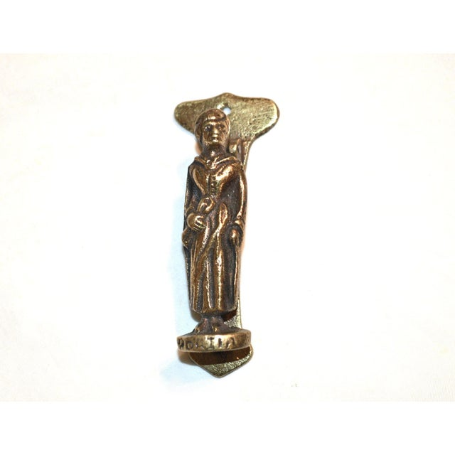 """A small door knocker featuring Portia, Shakespeare's heroine from """"The Merchant of Venice."""" She carries a scroll and her..."""