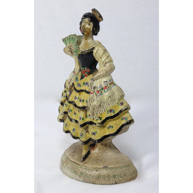 A cast iron Spanish Dancer Girl doorstop made by the Hubley Foundry USA. Original hand-painted features. Circa 1920s.