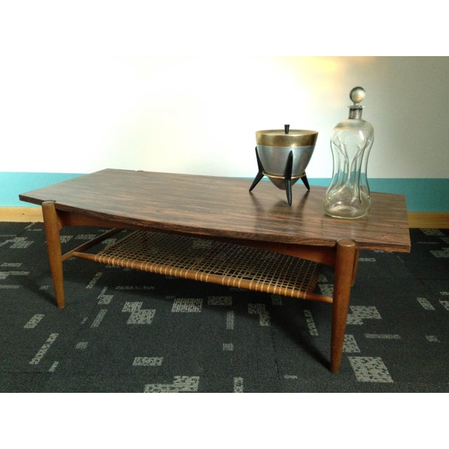 This vintage Mid Century Dux Coffee table design is attributed to Folke Ohlsson. It's Brazilian Rosewood formica top and...