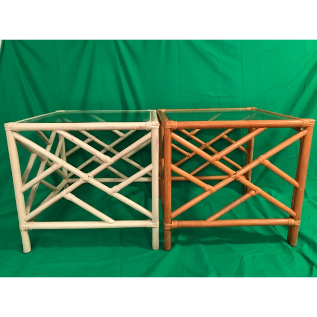 Vintage Chinese Chippendale rattan side tables and clear glass top. Brown is unaltered, white has been painted. All they...