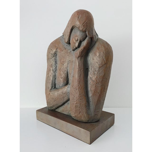 "Modern ""Head in Hand"" resin sculpture. The piece was made circa 2000s and is in excellent condition."