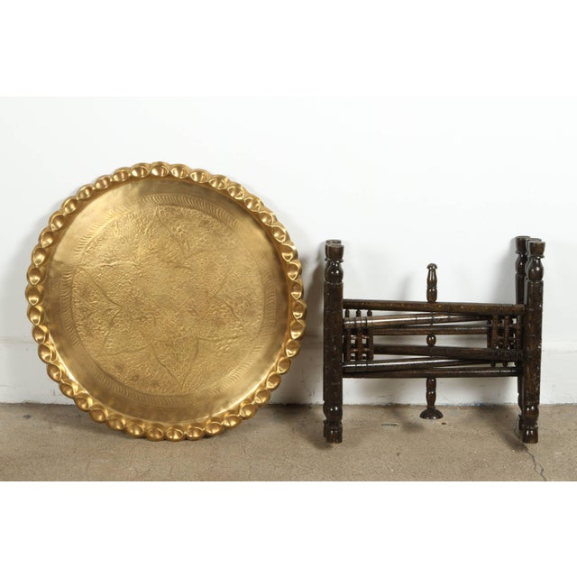 Vintage occasional Moroccan etched brass round tray table. This is a wonderful antique all hand tooled in exquisite...