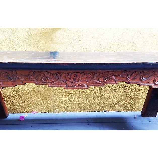 This is an antique Chinese solid wood bench with beautifully carved front legs, and the natural wood grain pattern and...