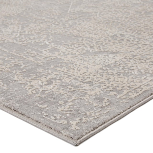 Muted color tones and distressed Oriental patterning combine to create the transitional appeal of this power-loomed area...