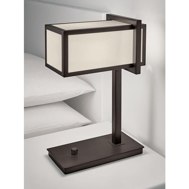 Black bronze rectangular metal frame with oyster fabric diffuser. Has a knurled rotary dimmer switch. Certification: IP20....