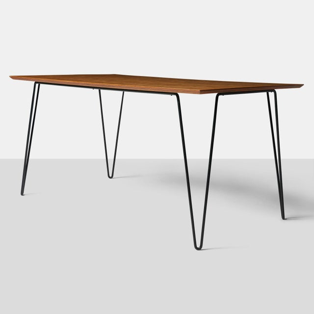 Dining Table by Dorothy Schindele A dining table by Dorothy Schindele with pale mahgany top and black iron hairpin legs....