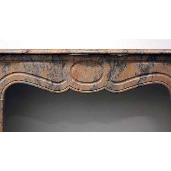 A small French pink rouge and gray colored Pompadour mantel. This is one of several additions from Danny Alessandro &...