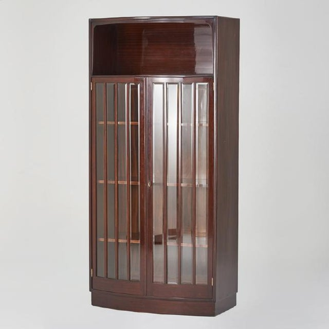 """European Art Deco mahogany and brass bowfront vitrine with beveled glass, circa 1930. Measurements: 74.75"""" H x 36"""" W x 18..."""