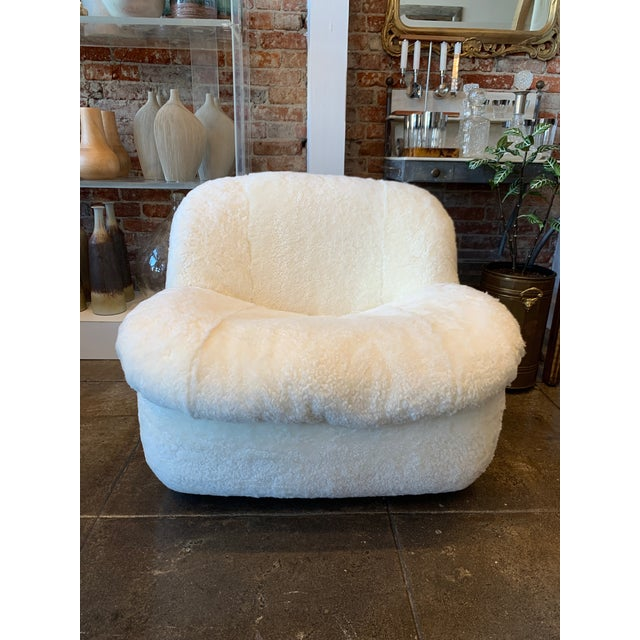 Cozy and large curly shearling swivel chair will be the star of the room and all about comfort. Just recovered it is...