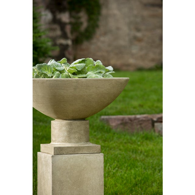 A clean-lined planter on a rectangular pedestal in a Verde finish. This listing is for the planter only. No plants are...