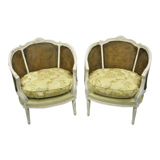 Vintage Mid Century Caned French Louis XVI Style White Distress Painted Bergere Salon Chairs- A Pair For Sale