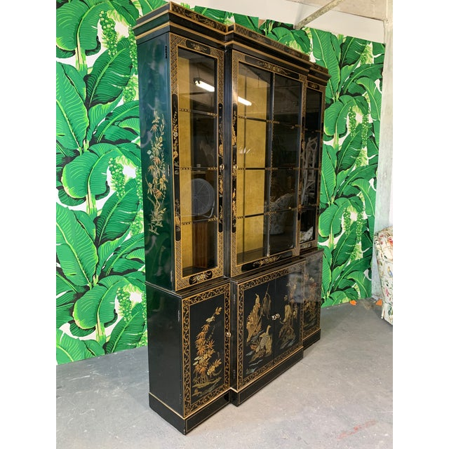 Black lacquered China cabinet by Drexel in Chinese chinoiserie style features hand painted murals and lighted interior...