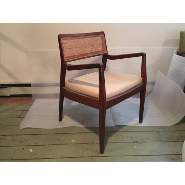 This is from the personal collection of the Risom Family. This single chair has a few spots on the white upholstery of the...