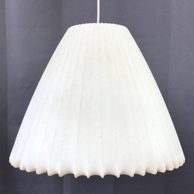 A very rare vintage bell-shaped hanging Bubble Lamp by George Nelson for the Howard Miller Clock Company. Designed in...