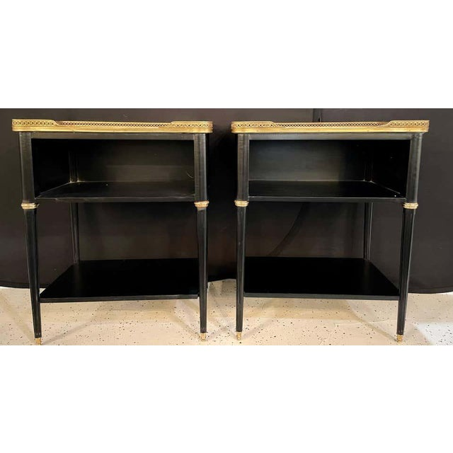 Pair of Hollywood Regency nightstands or end tables in the manner of Jansen. These finely crafted open end tables are...