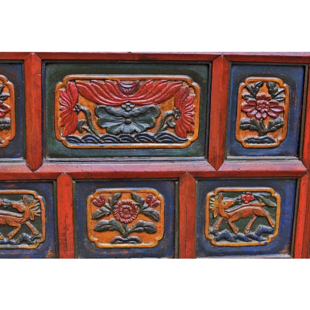 A beautiful, exotic chest from Tibet. The chest is hand painted with mineral colors. The blue originally came from the gem...