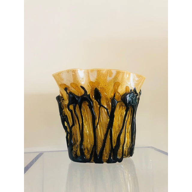 Mid Century Murano drip vase with caramel color glass with black drips. We have several of these vases all are listed...